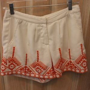White shorts with orange embroidery